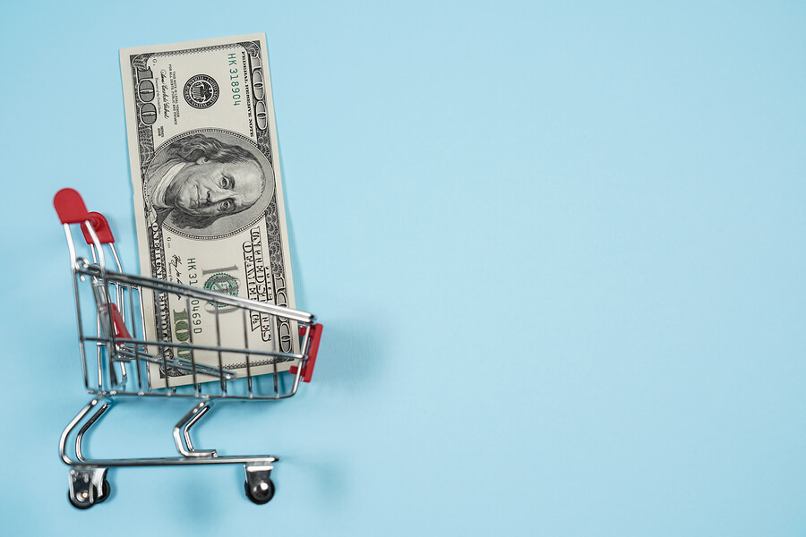 Us Dollars In Shopping Cart Over Blu Background ,dollar Bill Col